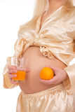 Pregnant woman holding fruit. Nine month. Stock Photography