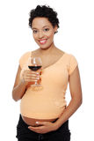 Pregnant woman holding a glass of wine. Stock Photo