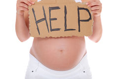 Pregnant woman holding help sign Stock Images