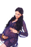 Pregnant woman holding her belly Royalty Free Stock Photos