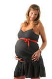 Pregnant woman holding her belly Royalty Free Stock Photography