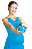 Pregnant woman holding  piggy bank Stock Photography