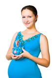 Pregnant woman holding  piggy bank Royalty Free Stock Photography