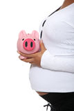 Pregnant woman holding piggy bank Stock Photos