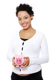 Pregnant woman holding piggy bank Royalty Free Stock Photo