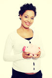 Pregnant woman holding piggy bank Royalty Free Stock Image