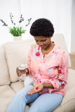 Pregnant woman holding pills and glass of water Royalty Free Stock Photos
