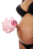 Pregnant woman holding a pink piggybank Royalty Free Stock Photo