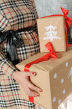 Pregnant woman holding present gift boxes Stock Photo