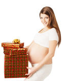 Pregnant woman holding present gift boxes Royalty Free Stock Photography