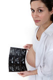 Pregnant woman holding x-ray image. Pregnant woman holding an x-ray image Royalty Free Stock Image