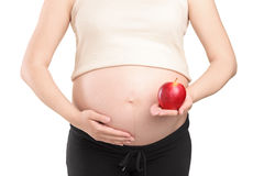 Pregnant woman holding a red apple Royalty Free Stock Photo