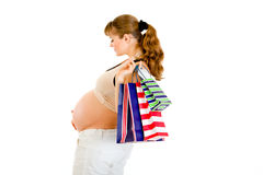 Pregnant woman holding shopping bags in hand Stock Photo