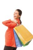 Pregnant woman holding shopping bags isolated Royalty Free Stock Photography