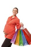 Pregnant woman holding shopping bags isolated Stock Photography