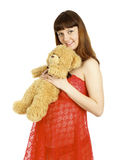 Pregnant woman holding teddy bear on her belly Stock Photography