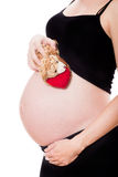Pregnant woman holding a teddy Stock Photo