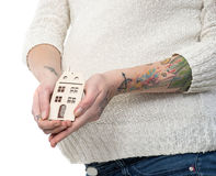 Pregnant woman holding wooden house Stock Image