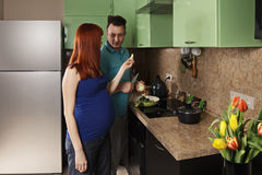 Pregnant woman holds apple slice Royalty Free Stock Photo
