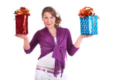 Pregnant woman holds boxes with gift Royalty Free Stock Photo