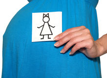 The pregnant woman holds the drawing of the girl on a white background Royalty Free Stock Photography