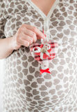 Pregnant woman holds heart. In hand Stock Photos