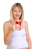 The pregnant woman holds a juice Stock Images