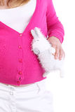 Pregnant woman holds white toy rabbit isolated. On white background. Rabbit listens baby vector illustration