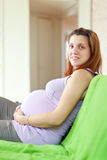 Pregnant woman in home Royalty Free Stock Image