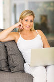 Pregnant woman home laptop Royalty Free Stock Images