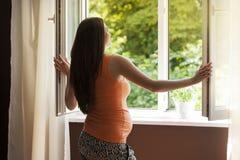 Pregnant woman at home stock photos