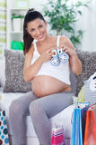 Pregnant woman at home after shopping Stock Image
