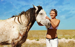 Pregnant woman and horse. Pregnant woman and white horse Stock Photos