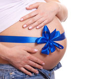 Pregnant woman hugs her belly Royalty Free Stock Images