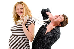 Pregnant woman with husband. A pregnant woman with her husband on a short leash Royalty Free Stock Photo