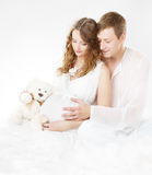 Pregnant woman with husband looking on belly Stock Image