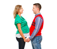Pregnant woman with husband looking on each other Stock Photo