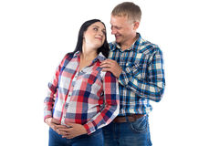 Pregnant woman and husband in shirt Royalty Free Stock Image