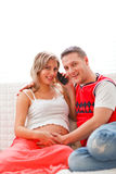 Pregnant woman with husband speaking mobile Stock Photo