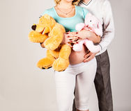 Pregnant woman with husband and toy Stock Photo