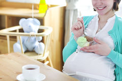 Pregnant woman with ice cream. Close up Stock Images
