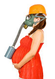 Pregnant Woman In Hardhat And Gas-mask Stock Image
