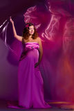 Pregnant Woman In Pink And Violet Dress 1 Stock Photos