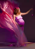 Pregnant Woman In Pink And Violet Dress 1 Royalty Free Stock Photos