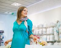 Pregnant Woman In Shop Store Royalty Free Stock Images
