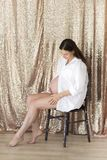 Pregnant woman indoors Royalty Free Stock Photo