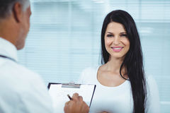 Pregnant woman interacting with doctor Royalty Free Stock Image