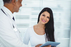 Pregnant woman interacting with doctor Stock Photography