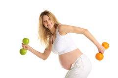 Pregnant Woman Involved In Fitness Dumbbells Royalty Free Stock Image