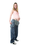 The pregnant woman in jeans Royalty Free Stock Photos